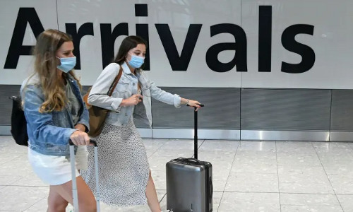 Mask-wearing travelers at the airport.